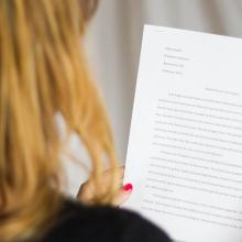 A student holding her essay