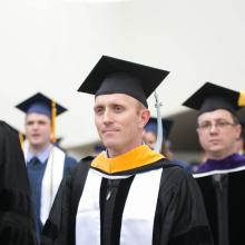 A group of graduating students in their caps and gowns
