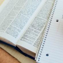 Open Scriptures with a page of notes